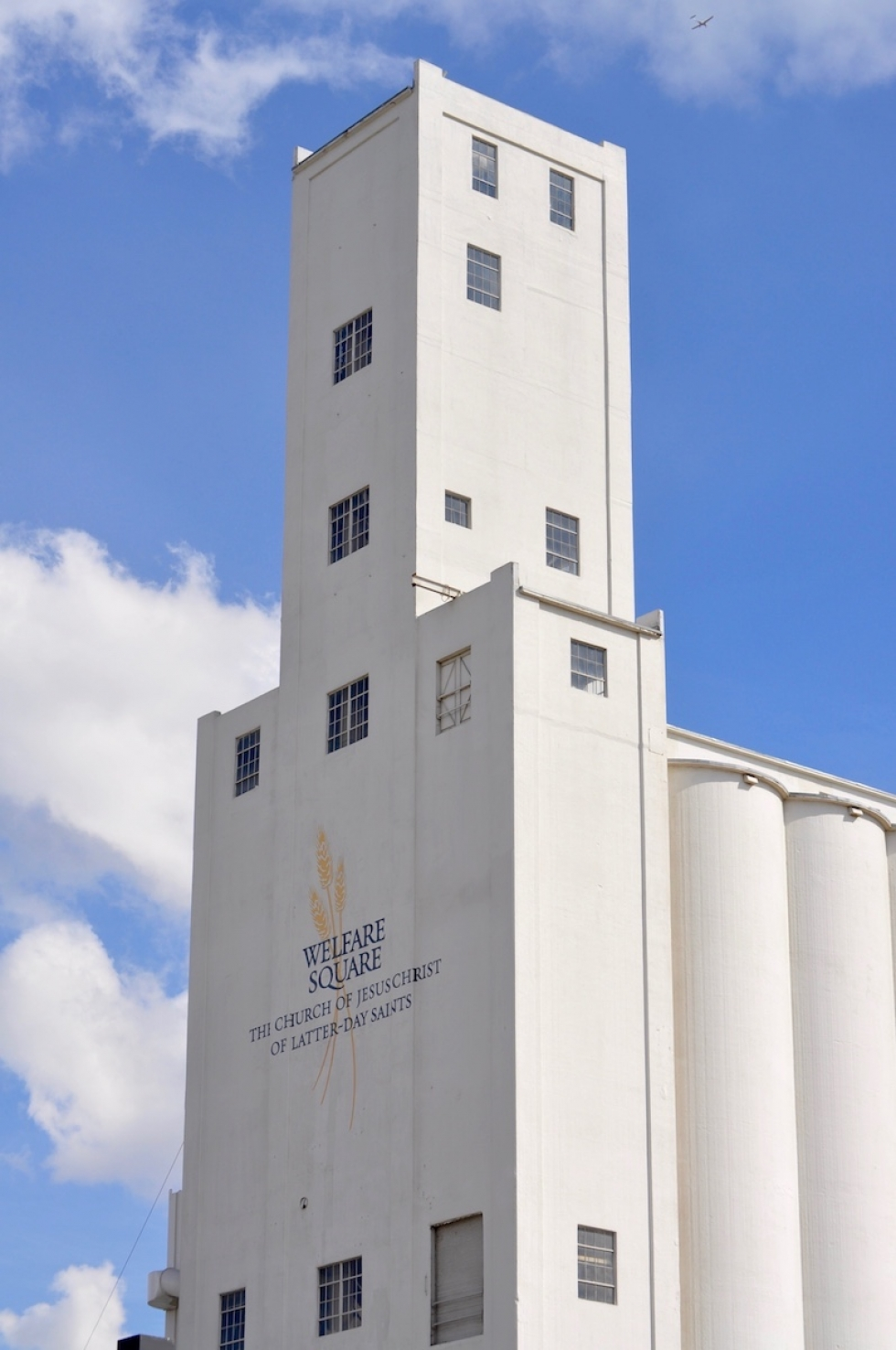 The iconic,178-foot bread silo of Welfare Square rises above the west side of Salt Lake City, on the edge of Poplar Grove and what is now called the Granary District. The Church of Jesus Christ of Latter-Day Saints established its welfare program in 1936, eighty years ago.