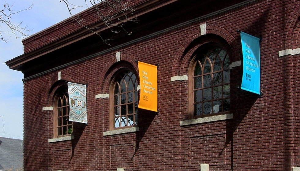 The City Library decorated the historic Chapman Branch Library with a half-dozen colorful banners celebrating one hundred years on the West Side of Salt Lake City during 2018.
