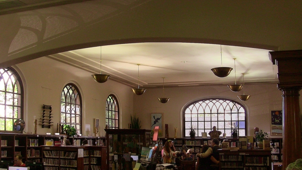 The comfortable interior of the Chapman Branch Library retains most of its look and feel after one hundred years of continuous use, despite details installed over the years to keep pace with changing times and some necessary repair and restoration after snow damage in the 1990's.