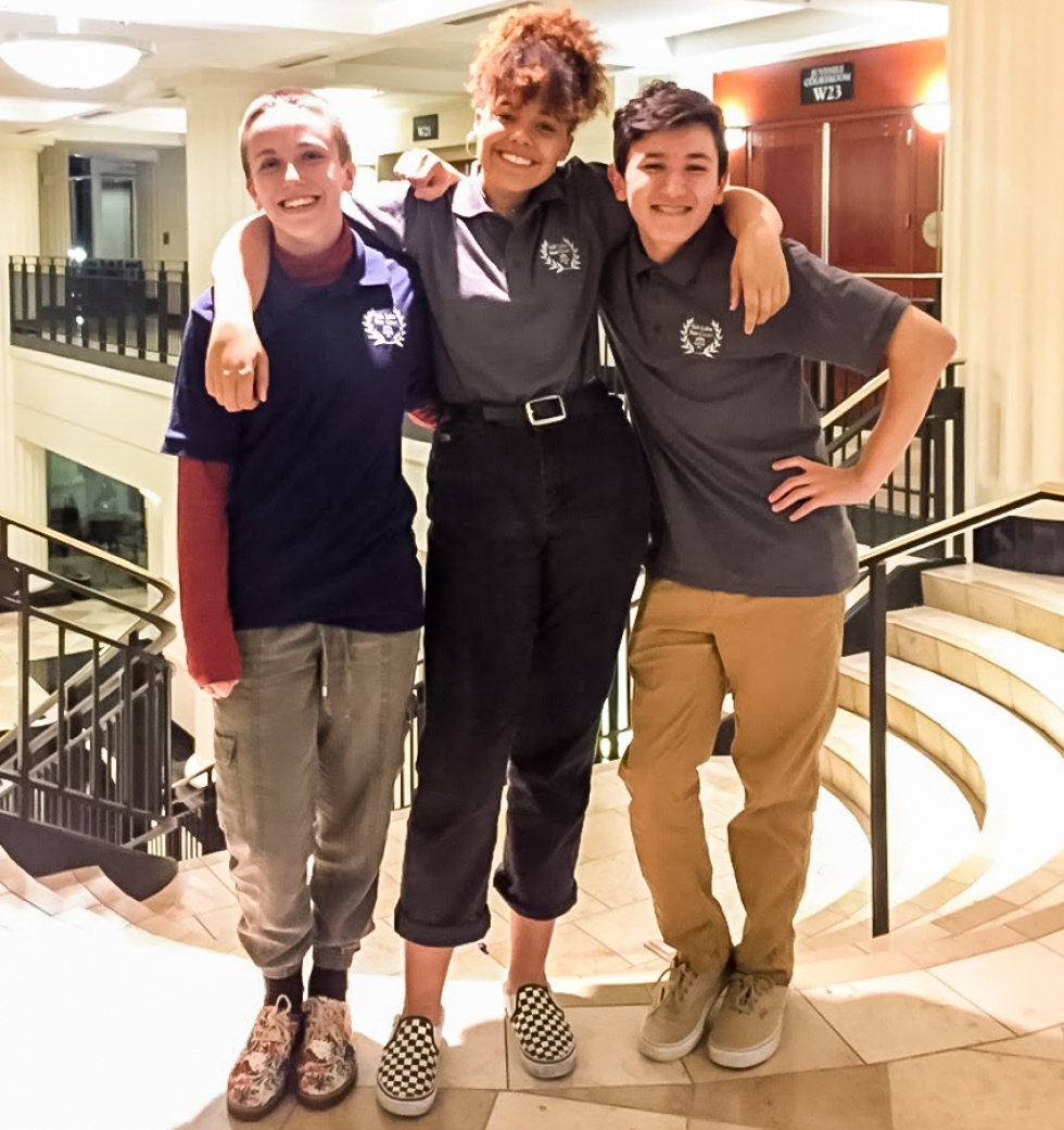 Three of the youth volunteers for Salt Lake Peer Court pose for a photo in the Matheson Courthouse. From left to right: Emery Hovermale, Kayla Williams, and Jesse Gonzalez.    Photo courtesy of Salt Lake Peer Court