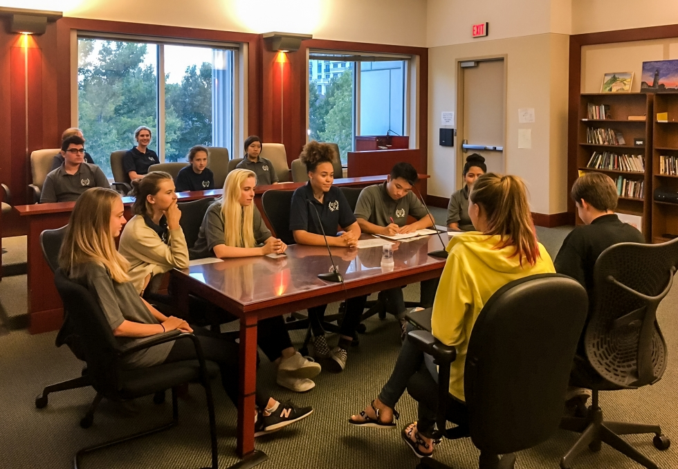 Salt Lake Peer Court volunteers hold a mock hearing in the Matheson Courthouse as part of their training to hear cases and determine what course of action referred youth and their parent/legal guardian must fulfill.  Photo by Charlotte Fife-Jepperson