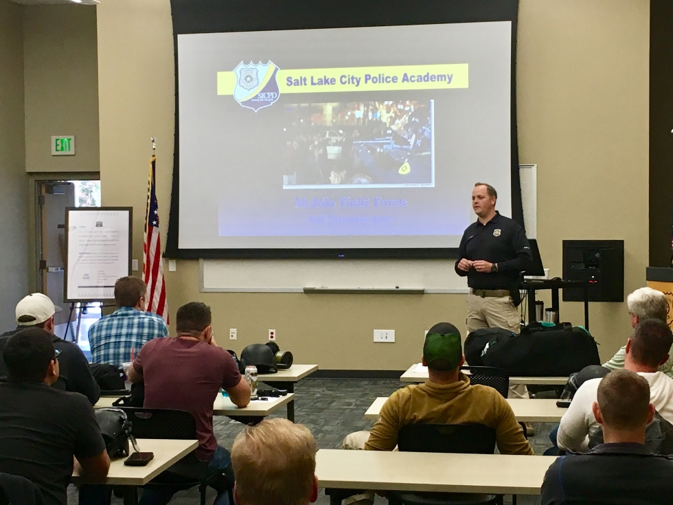 Training Lieutenant Eddie Cameron teaches a class to members of the Salt Lake City Police Department at the Pioneer Police Precinct in October. It will take two more years to get the entire department rotated through the de-escalation training courses.      Photo by Charlotte Fife-Jepperson