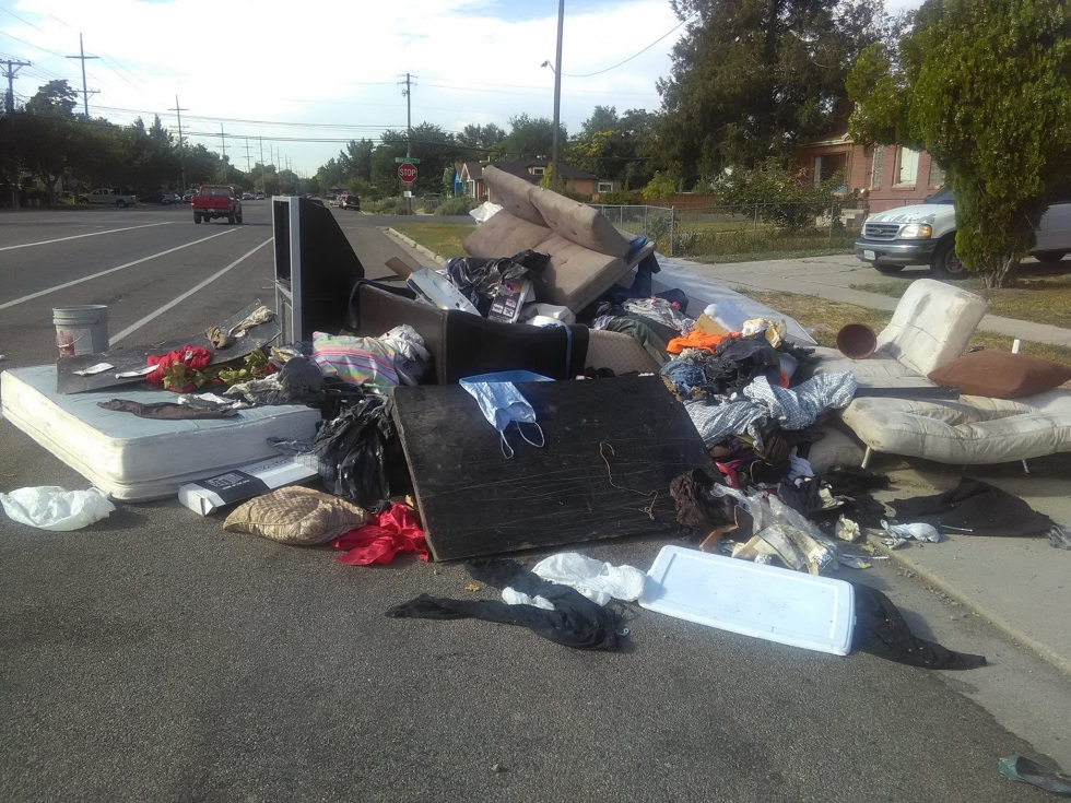 Trash piles, like this one on 10th West between 200 and 300 South in 2017, seemed to appear and expand in the summer months while the city's annual curbside cleanup was going on. The new Call 2 Haul program should alleviate this problem.  Photo by Lance H