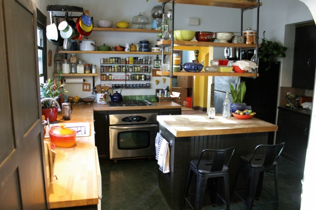 Kitchen: A retired electrician's workbench was turned into the center-island butcher block.|Living room: The 1910's chandelier is a literal red light from a Carson City Brothel.||||