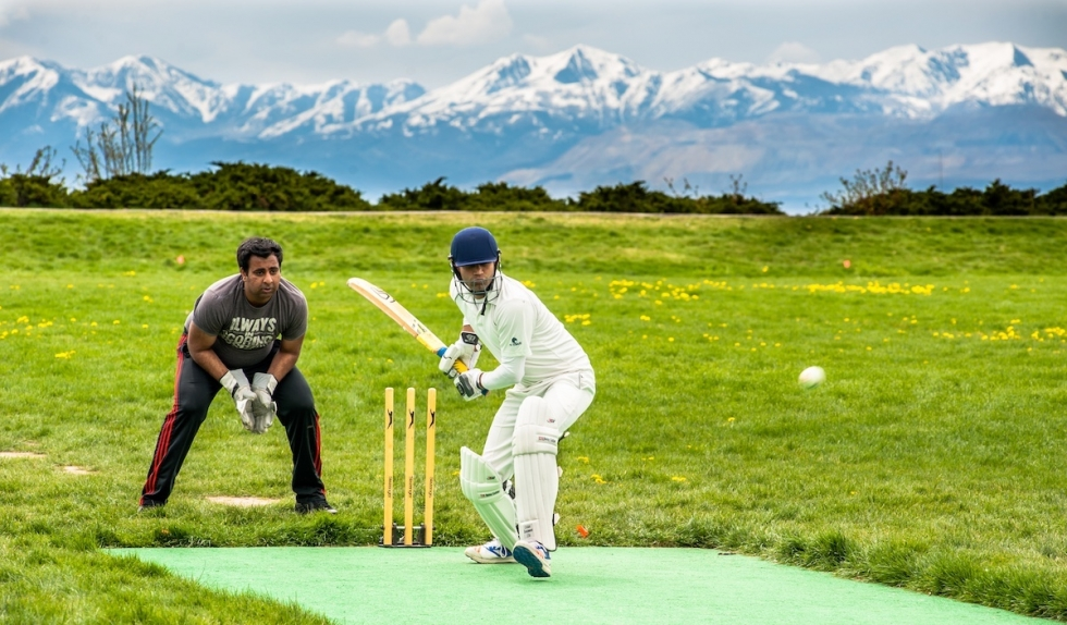 """Faisal Wahid, covered in protective gear, takes a turn as """"batsman"""" in a game of cricket at the 11th Avenue Park on April 23.  Photo by David Ricketts"""