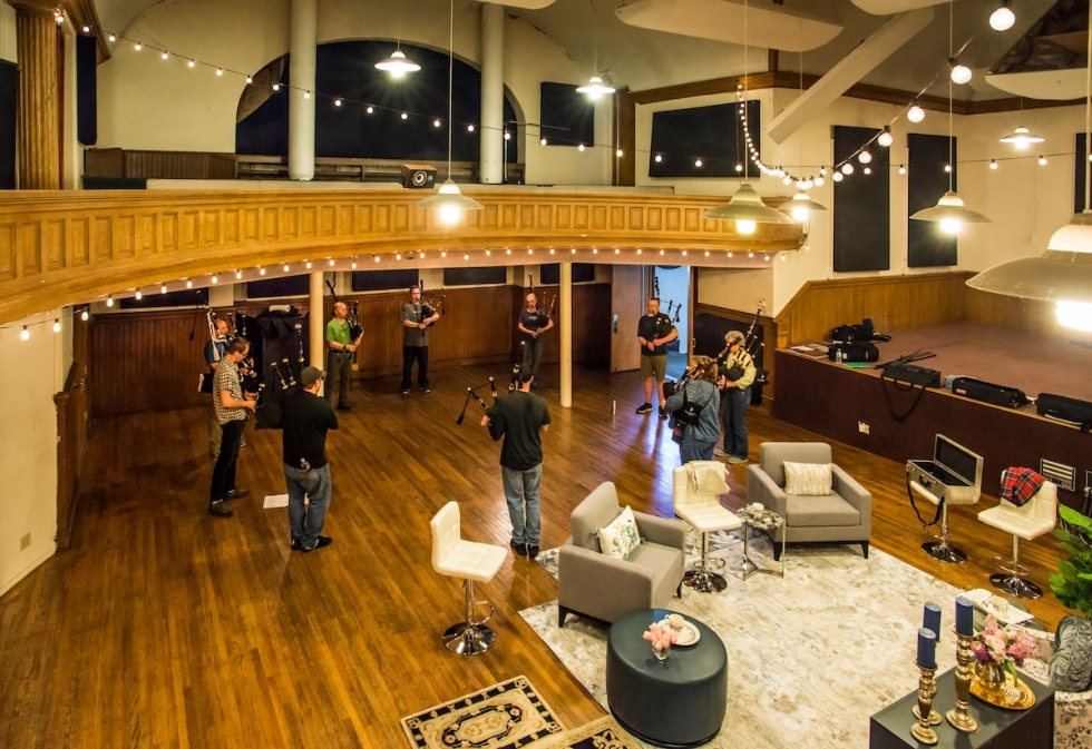 Members of the Wasatch & District Pipe Band rehearse in the chapel area of the Art Castle purchased by the Arts Alliance in the winter of 2021.