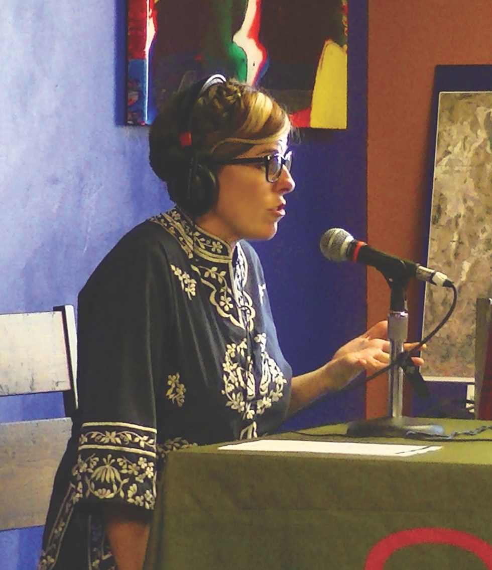 """Megan Hallett of Framework Arts discusses how her students at Escalante Elementary, created the art installation """"Work/Trabajo"""" with their parents on KRCL 90.9 FM during its opening evening at Mestizo Coffeehouse."""