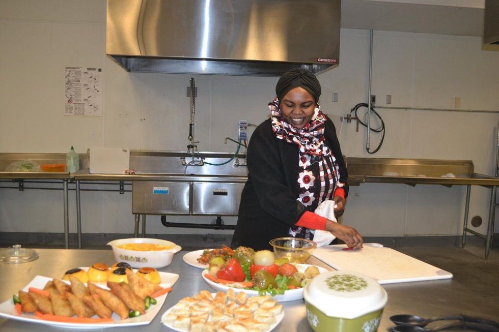 An entrepreneur prepares her traditional food at the Spice Kitchen for a catering event.