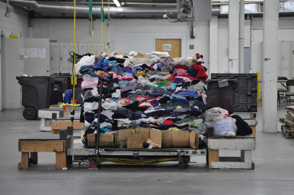 A huge stack of clothes is ready for processing at the Latter-Day Saints Humanitarian Center located at 1665 Bennett Road (2030 West). The center offers aid to people worldwide and employment skills to immigrants and New Americans who work in the warehouse.