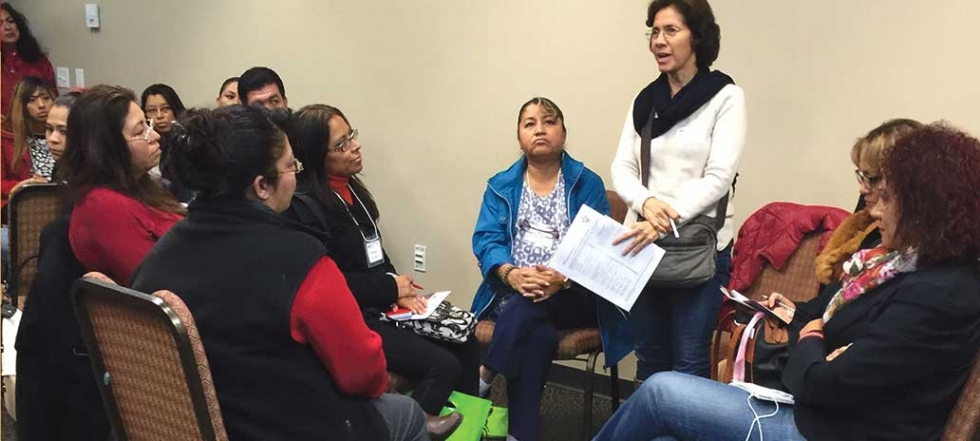 A peer mentor speaks to a group of women about mental health. Latino Behavioral Health Services operates as a peer-run organization in a supportive group environment.   Photo courtesy of Latino Behavioral Health Services