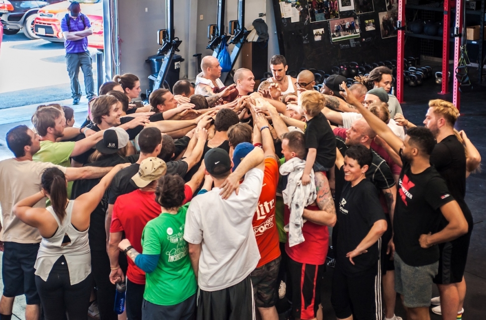 The free Saturday Boot Camp workouts at the Fit to Recover gym draw large numbers each week. Coaches and participants support one another during the workouts and in their recovery from addiction.