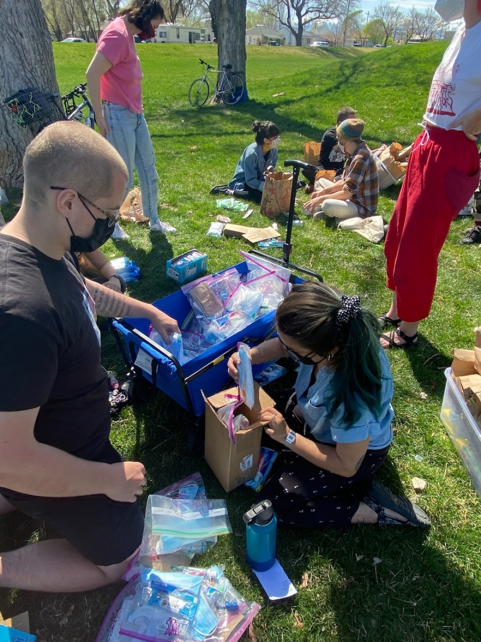 Volunteers meet at Jefferson Park in the Ballpark Neighborhood to assemble hygiene kits before passing out the kits to encampments throughout the city.   Photo by Roberto Elguera