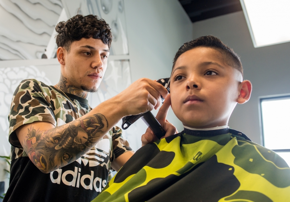 Break Bread Barber Co. owner, Ricky Arriola, gives just as much attention to young customers as adults.   Photos by David Ricketts