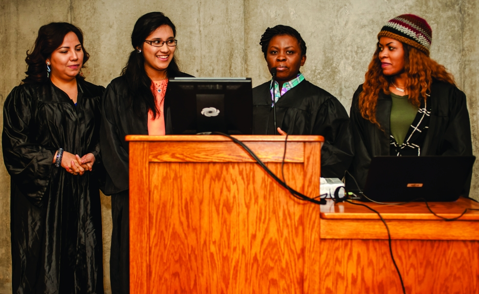 Elizabeth Gamarra (second from left) presents the idea for the Waves Project with her teammates at the WLI graduation ceremony in December. PHOTO BY: DAVID RICKETTS