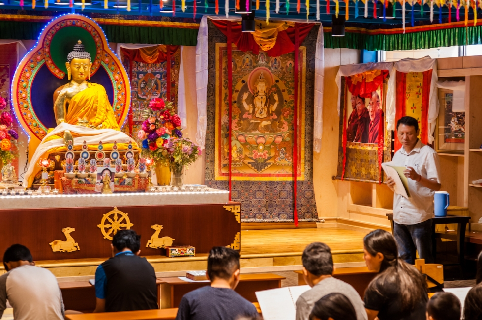 Lobsang Gendun leads Tibetan youths in prayer at the Tibetan Community Center in June.