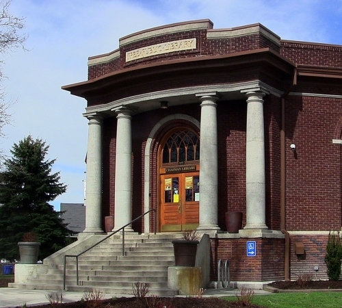 "The historic Chapman Branch building, constructed by Ashton Improvement Company between 1917 and 1918, was one of twenty-seven libraries built in Utah with financial help from the Andrew Carnegie Foundation. The intentionally high stairs supposedly represented ""ascending knowledge,"" but nowadays there is also a practical ramp and elevator on the south side.