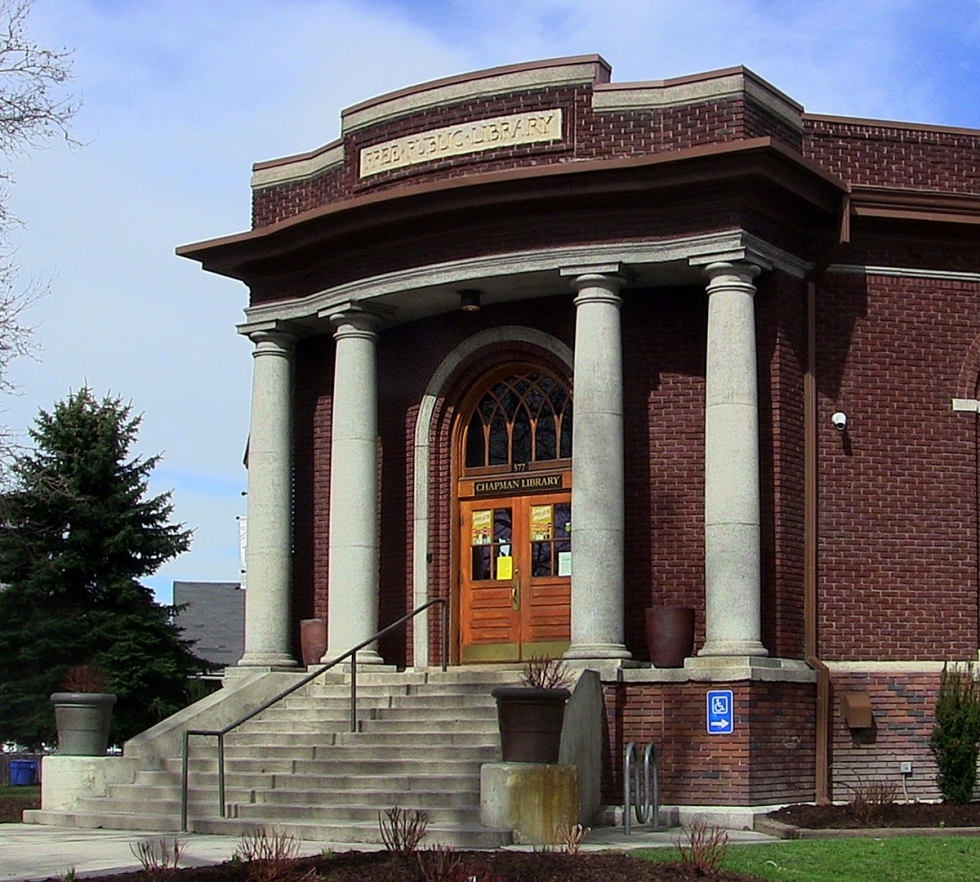 "The historic Chapman Branch building, constructed by Ashton Improvement Company between 1917 and 1918, was one of twenty-seven libraries built in Utah with financial help from the Andrew Carnegie Foundation. The intentionally high stairs supposedly represented ""ascending knowledge,"" but nowadays there is also a practical ramp and elevator on the south side."