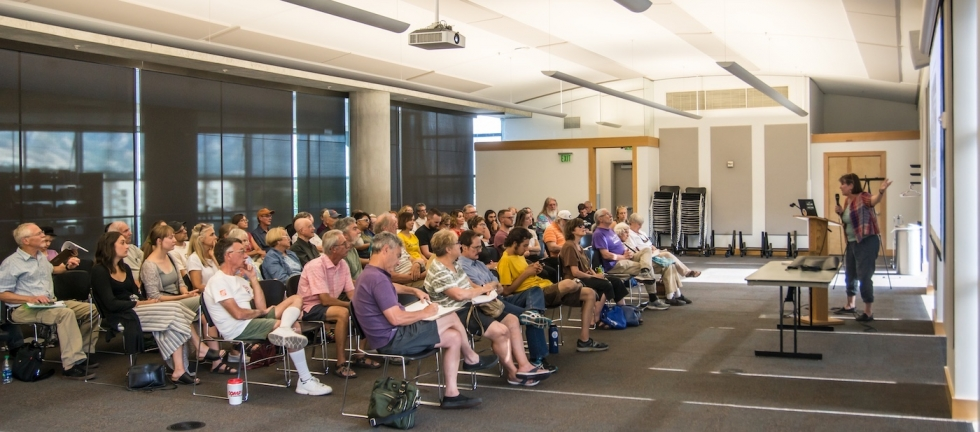 Deeda Seed of the Center for Biological Diversity gives a power point presentation to a large crowd of concerned citizens who met to plan their opposition to the 1st Phase of the Inland Port on August 19 at the Salt Lake City Main Library.  Photos by David Ricketts