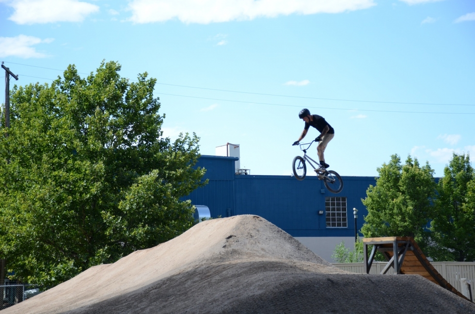 Cyclist takes to the dirt jumps at Poplar Grove's 9Line Bike Park, part of the city's Trails and Natural Lands division, which relies on volunteers to help change up and maintain.