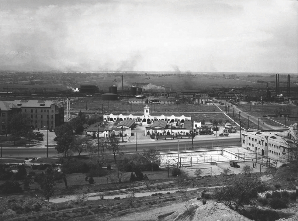 Westward view of Salt Lake Valley from Victory Road circa 1937, immediately above Warm Springs Plunge (lower right.) Directly across Beck Street, the Mission Motel served travelers, plus friends and families of patients in old St. Marks Hospital (middle left.) In the middle distance, beyond the tracks and rail yards, a line of trees defines the Jordan River and Redwood Rood beyond it. Rose Park began to be built a decade later between 900 West and the Jordan River. Historic photo from a P.D. source.