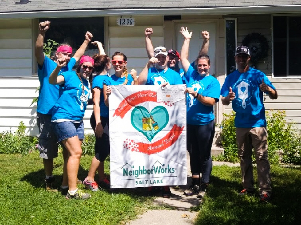 Corinne Piazza poses with a group of volunteers from the Young Realtors.  Photos courtesy of NeighborWorks Salt Lake