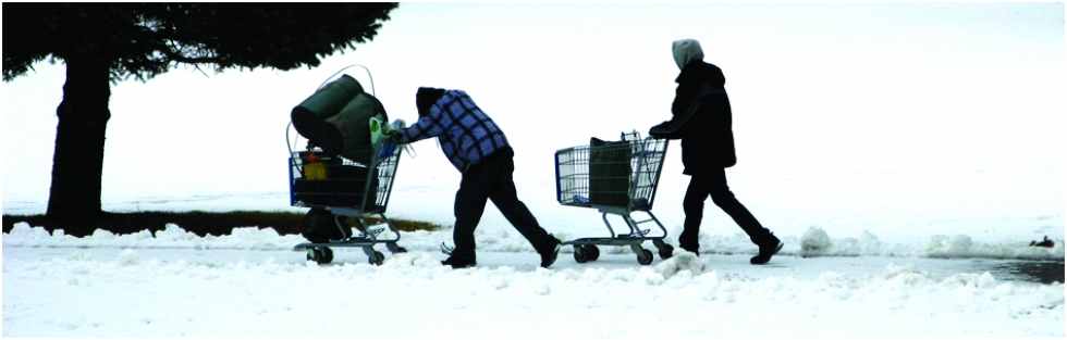 People push shopping carts full of their belongings on the Jordan River Parkway Trail during winter. It is a common sight on Salt Lake City's west side, as more and more people are braving the elements to live and sleep outdoors on public lands.