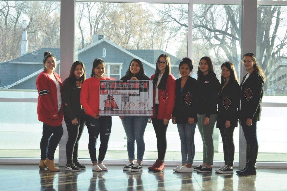 Casa Quetzalcoatl students from West High School pose for a photo at the Marmalade Branch Library. From left to right: Ashley Mercado,Tania Hernandez, Alexia Lopez, Maricela Puerta, Paola Cervantes, Sandra Inga, Arumy Fuentes, Magaly Chavez, and Grettel Garcia