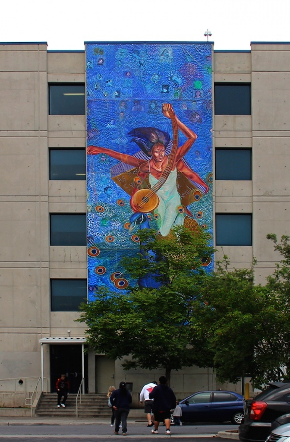 """""""Saraswati,"""" Ruby Chacon's first mural for Horizonte took several years to paint, with an ever-changing crew of students. The four-story mural has graced the west side of the building on Richards Street near 1300 South for almost a decade."""