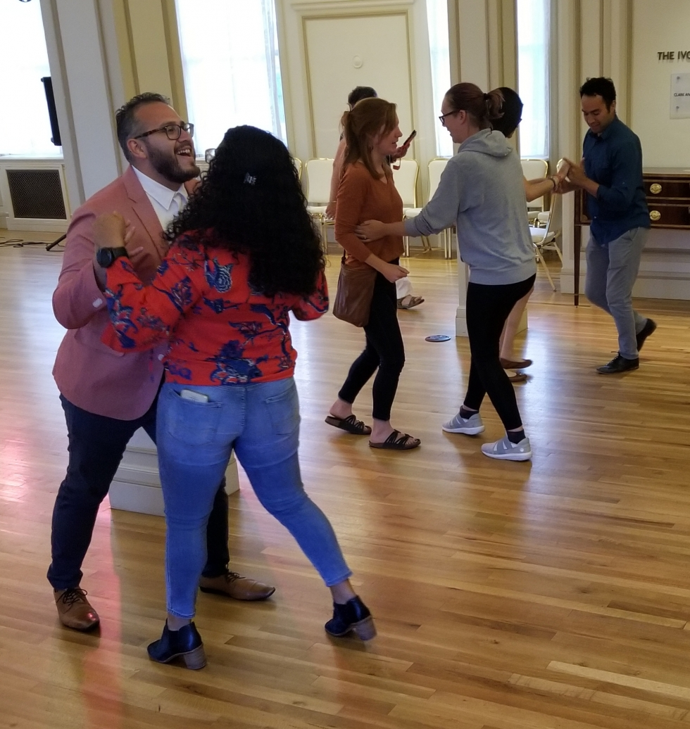 After the planning and educational events of the summit, the group had a public celebration including Latin music and dancing, a silent auction, and a loteria.  Photo by Joseph Arrington