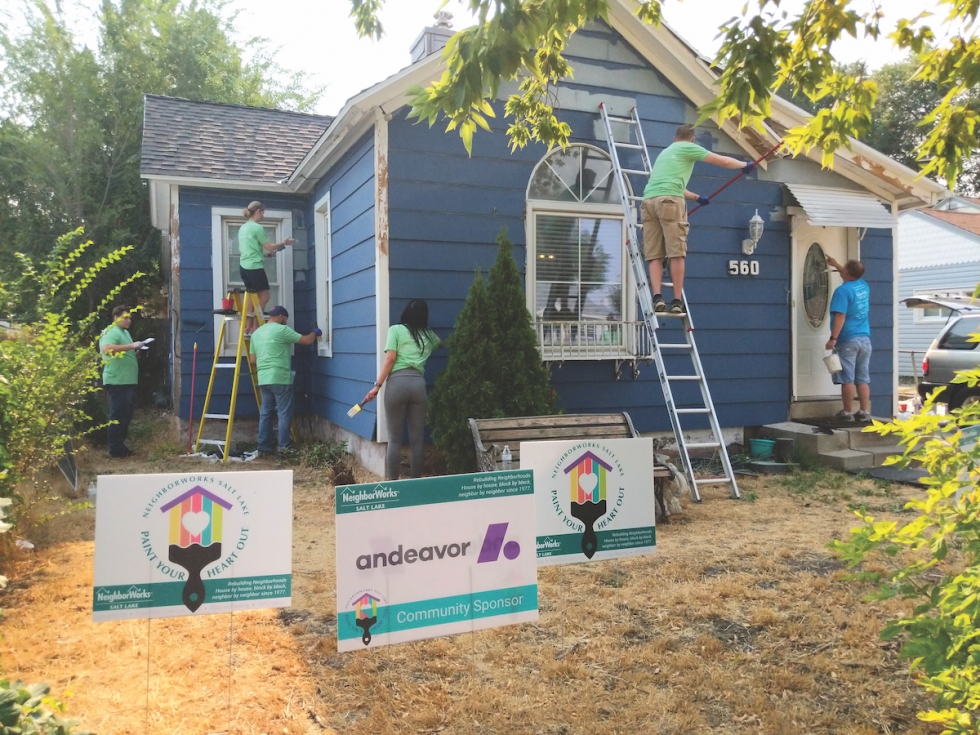 US Bank volunteer team work on the Gamez home in Fairpark during the 2018 Paint Your Heart Out event.