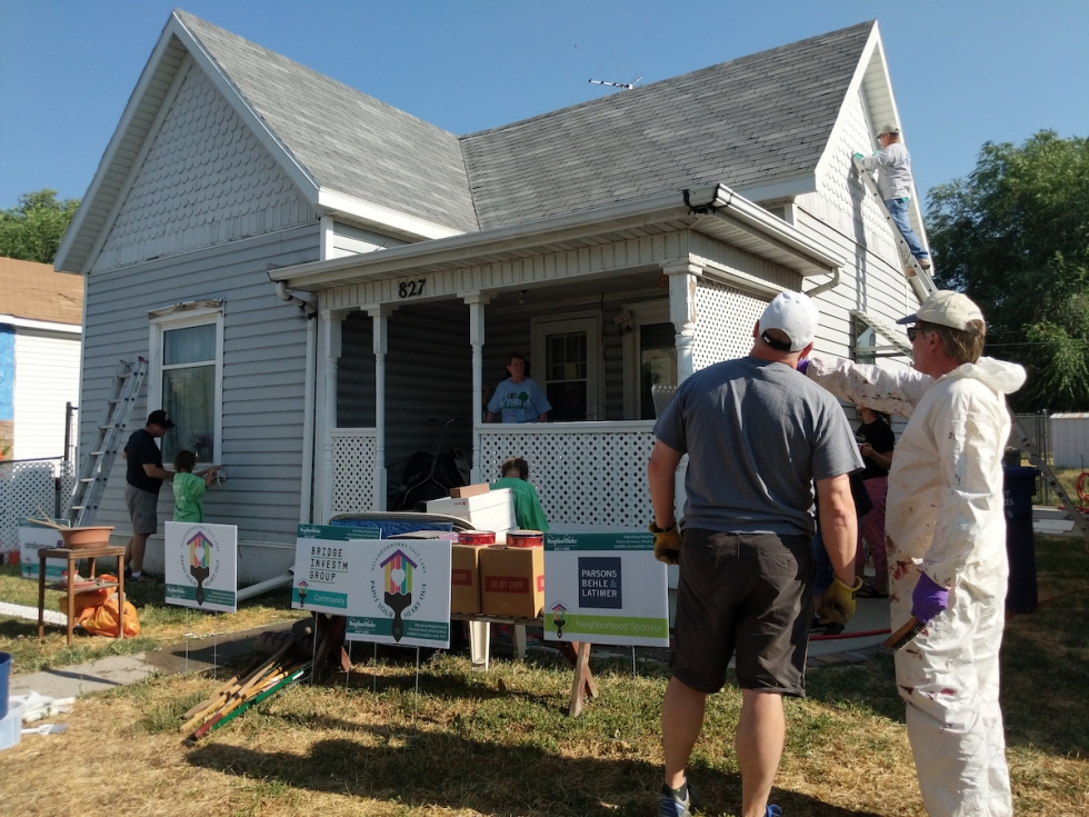 NeighborWorks Salt Lake Board and families paint the Yancey home in Fairpark during the 2018 Paint Your Heart Out event.