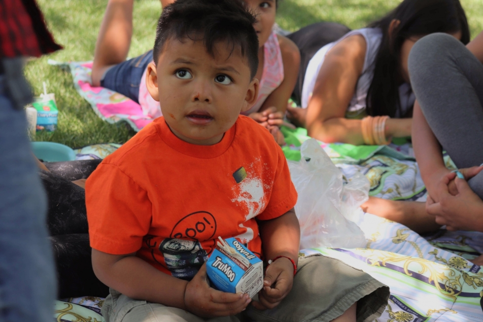 Jaziel, age 2, sips his chocolate milk after eating his free lunch at Sherwood Park on July 1.     Photo by Cameron Jepperson