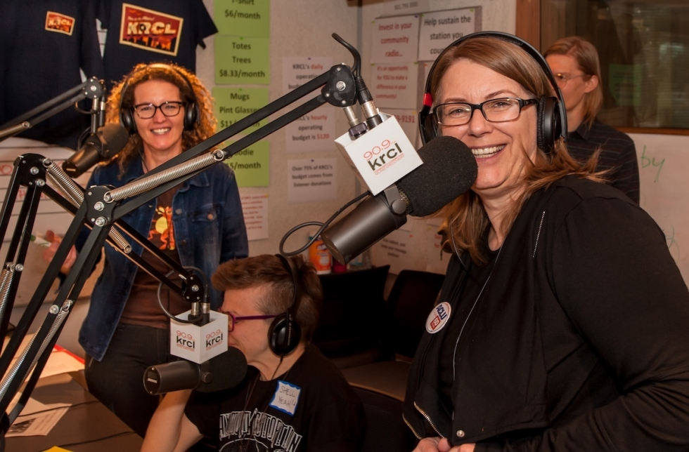 Midday Show Host Eugenie Hero Jaffe and Lara Jones, Community Content Manager and RadioActive Host, reach out to listeners alongside volunteers during Spring Radiothon at the KRCL 90.9 FM studios.