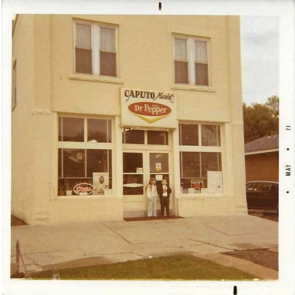 The Cap Market with Dr Pepper sign is the first Rose Park store