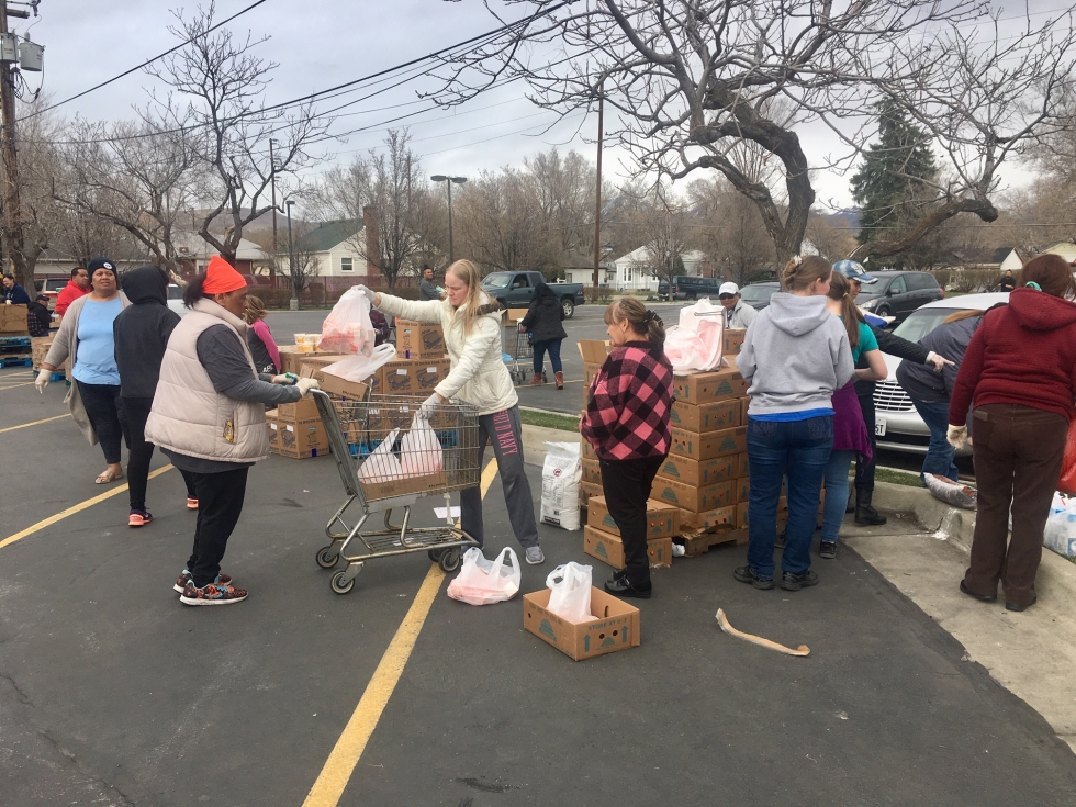 Volunteers from the Church of Jesus Christ of Latter Day Saints' Cannon Stake distribute food to people in need on March 18, the day a major earthquake hit Salt Lake City.     Photos by Charlotte Fife-Jepperson