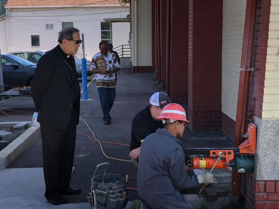 Acting on a hunch, parish officials discovered a 100-year old time capsule in the cornerstone of St. Patrick's Church.  Photos courtesy of Intermountain Catholic