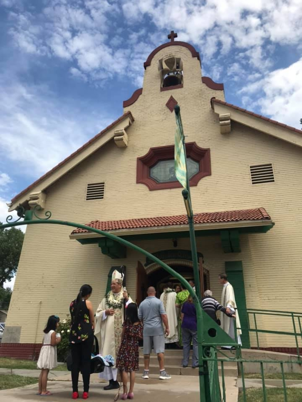 Most Reverend Oscar A. Solis, Bishop of the Catholic Diocese of Salt Lake City, greets parishioners of Saint Patrick's Church before the mass for the 100th anniversary of the dedication of the church. Photos courtesy of Intermountain Catholic