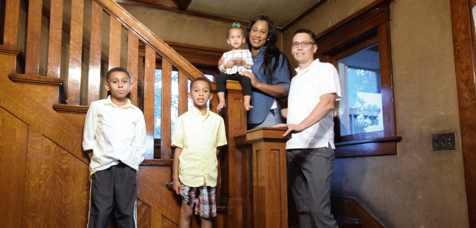 The Stowells manage to gather their family for a self-portrait in front of the original oak staircase in their beautiful, old home in Poplar Grove.