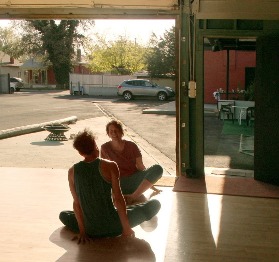 """Dancers Amy Freitas and Keanu Brady from the collective """"Porridge for Goldilocks"""" improvise to live music in the green Studio Building at Sugar Space on a summer afternoon."""